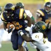 UCO\'s Joshua Birmingham tries to get by Missouri Southern\'s Demon Haire during the college football game between the University of Central Oklahoma and Missouri Southern at Wantland Stadium in Edmond, Okla., , Thursday, Aug. 30, 2012. Photo by Sarah Phipps, The Oklahoman KOD