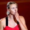 Russia\'s Maria Sharapova blows a kiss after beating Australian Samantha Stosur 6-7, 7-6, 7-6 during their quarterfinal match at the Porsche tennis Grand Prix in Stuttgart, Germany, Friday, April 27, 2012. (AP Photo/Michael Probst) ORG XMIT: PSTU126