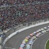 Drivers take the green flag to start a NASCAR Sprint Cup race at Kansas Speedway in Kansas City, Kan., Sunday, April 21, 2013. (AP Photo/Colin E. Braley)