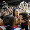 The Millwood team, including Quira Demery lift the trophy following their 64-50 win over Prague in the Class 3A girls high school state basketball championship game at State Fair Arena in Oklahoma City, Saturday, March 10, 2012. Photo by Bryan Terry, The Oklahoman