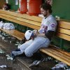 New York Mets starting pitcher R.A. Dickey sits alone in the dugout following his team\'s 6-5 loss to the Washington Nationals in a baseball game in Washington, Saturday, July 3, 2010. (AP Photo/Ann Heisenfelt) ORG XMIT: NAT113
