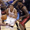 Oklahoma City\'s Russell Westbrook (0) drives past Miami\'s LeBron James (6) during Game 2 of the NBA Finals between the Oklahoma City Thunder and the Miami Heat at Chesapeake Energy Arena in Oklahoma City, Thursday, June 14, 2012. Photo by Chris Landsberger, The Oklahoman