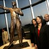 Sherri Harris, Kelli Jones, and Charles T Hall, (from left to right) pose by a statue of their father Charles B. Hall during the unveiling of a life sized statue of Tuskegee Airman Charles B. Hall at the Oklahoma History Center in Oklahoma City on Thursday, Sept. 20, 2007. By John Clanton, The Oklahoman
