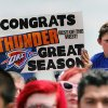 Thunder fans wait for the teams arrival in high temperatures at a welcome home rally for the Oklahoma City Thunder in a field at Will Rogers World Airport after the team\'s loss to the Miami Heat in the NBA Finals, Friday, June 22, 2012. Photo by Nate Billings, The Oklahoman