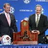 Photo - Auburn coach Gus Malzahn, left, and Missouri coach Gary Pinkel laugh as they pose with the Southeastern Championship trophy during a press conference the day before the SEC football championship game,  at the Georgia Dome, Friday, Dec. 6, 2013,  in Atlanta, Ga., (AP Photo/Atlanta Journal-Constitution, Jason Getz) )  MARIETTA DAILY OUT; GWINNETT DAILY POST OUT; LOCAL TV OUT; WXIA-TV OUT; WGCL-TV OUT