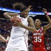 Courtney Paris pulls in a rebound in front of Angel McCoughtry in the first half as the University of Oklahoma plays Louisville at the 2009 NCAA women\'s college basketball tournament Final Four in the Scottrade Center in Saint Louis, Missouri on Sunday, April 5, 2009. Photo by Steve Sisney, The Oklahoman ORG XMIT: KOD