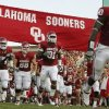 The Oklahoma football team takes the field before the college football game between the University of Oklahoma Sooners ( OU) and the Tulsa University Hurricanes (TU) at the Gaylord Family-Memorial Stadium on Saturday, Sept. 3, 2011, in Norman, Okla. Photo by Bryan Terry, The Oklahoman ORG XMIT: KOD