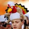 Katie Andrews, 12, wears an elaborate turkey hat as she waits for the 5K run to start during the annual Turkey Trot in downtown Edmond Thursday morning, Nov. 24, 2011. Andrews , who lives in Arkansas, is in Edmond visiting her grandparents for the holiday. This was her first time to participate in the Turkey Trot. Photo by Jim Beckel, The Oklahoman