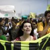 Photo - People shout slogans during a protest, at Independence Day in Brasilia, Brazil, Saturday, Sept. 7, 2013. (AP Photo/Felipe Dana)