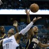 Orlando Magic\'s Glen Davis (11) and Indiana Pacers\' David West (21) battle for a rebound during the first half of an NBA basketball game, Wednesday, Jan. 16, 2013, in Orlando, Fla. (AP Photo/John Raoux)