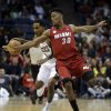 Milwaukee Bucks\' Brandon Jennings, left, tries to drive past Miami Heat\'s Norris Cole (30) during the second half of Game 3 in their first-round NBA basketball playoff series on Thursday, April 25, 2013, in Milwaukee. (AP Photo/Morry Gash)