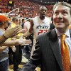 OSU head coach Travis Ford smiles at fans as he and James Anderson (23) leave the court after the men\'s college basketball game between the University of Kansas (KU) and Oklahoma State University (OSU) at Gallagher-Iba Arena in Stillwater, Okla., Saturday, Feb. 27, 2010. OSU won, 85-77. Photo by Nate Billings, The Oklahoman