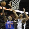 New York Knicks\' Ronnie Brewer, left, shoots over San Antonio Spurs\' Tim Duncan during the first half of an NBA basketball game on Thursday, Nov. 15, 2012, in San Antonio. (AP Photo/Darren Abate)