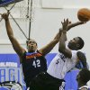 Photo - Orlando Magic's Victor Oladipo (5) takes a shot over Oklahoma City Thunder's Ron Anderson (42) during an NBA summer league basketball game, Monday, July 8, 2013, in Orlando, Fla. (AP Photo/John Raoux) ORG XMIT: DOA107