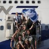 New Jewish immigrants from U.S. wave an Israeli flag as they arrive at the Ben Gurion airport near Tel Aviv, Israel, Tuesday, Aug. 14, 2012. A total of 350 immigrants arrived on the flight from the U.S. Tuesday, and were welcomed by Israel\'s Prime Minister Benjamin Netanyahu in a ceremony at the airport. Over 100 of the new immigrants are expected to join the Israel Defense Forces in the upcoming month. (AP Photo/Oded Balilty)