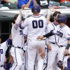 Photo - TCU's Kevin Cron (00) celebrates with his team after scoring a run in the third inning of the championship game against Oklahoma State in the Big 12 conference NCAA college baseball tournament in Oklahoma City, Sunday, May 25, 2014. (AP Photo/Alonzo Adams)