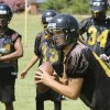 Midwest City\'s Brendan Brown looks for a receiver during practice in Midwest City, Tuesday August 12, 2014. Photo By Steve Gooch, The Oklahoman
