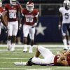 OU quarterback Sam Bradford (14) lays on the turf after being injured late in the second quarter during the college football game between the Brigham Young University Cougars (BYU) and the University of Oklahoma Sooners (OU) at Cowboys Stadium in Arlington, Texas, Saturday, September 5, 2009. Bradford left the field after the play and did not return. BYU won, 14-13. By Nate Billings, The Oklahoman
