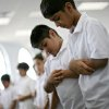 Ali Saif (right), a third-grader, prays with his classmates at Mercy School in Oklahoma City on Tuesday, August 17, 2010. Photo by John Clanton, The Oklahoman