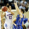 Hammon\'s Peyton Walker (23) looks to pass the ball away from Lomega\'s Kylie Turner (10) during a Class B Girls semifinal game of the state high school basketball tournament between Hammon and Lomega at Jim Norick Arena, The Big House, on State Fair Park in Oklahoma City, Friday, March 1, 2013. Lomega won, 60-52. Photo by Nate Billings, The Oklahoman