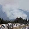 Photo - A wildfire burns on the foothills of the San Gabriel Mountains above Monrovia, Calif., on Saturday, April 20, 2013. The view of the blaze slowed traffic to a crawl on Interstate 210 northeast of  Los Angeles. (AP Photo/John Antczak)