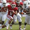 OU\'s Dominique Whaley (8) runs past UT\'s Steve Edmond (33) during the Red River Rivalry college football game between the University of Oklahoma (OU) and the University of Texas (UT) at the Cotton Bowl in Dallas, Saturday, Oct. 13, 2012. Photo by Chris Landsberger, The Oklahoman
