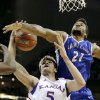 Kansas center Jeff Withey (5) and Saint Louis forward Dwayne Evans (21) battle for a rebound during the first half of an NCAA college basketball game, Tuesday, Nov. 20, 2012, in Kansas City, Mo. (AP Photo/Charlie Riedel)