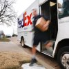 Carrying a parcel in one hand, longtime FedEx driver Ray Beltrane rushes out of his truck to deliver packages to homes in northwest Oklahoma City on Monday, Dec. 12, 2011. Photo by Jim Beckel, The Oklahoman