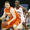 Oklahoma\'s Willie Warren (13) defends on Syracuse\'s Eric Devendorf (23) during the first half of the NCAA Men\'s Basketball Regional at the FedEx Forum on Friday, March 27, 2009, in Memphis, Tenn. PHOTO BY CHRIS LANDSBERGER, THE OKLAHOMAN
