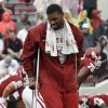 Photo - INJURY / INJURED: Oklahoma's Jermaine Gresham walks on crutches before the first half of the college football game between The University of Oklahoma Sooners (OU) and Idaho State University Bengals (ISU) at the Gaylord Family -- Oklahoma Memorial Stadium on Saturday, Sept. 12, 2009, in Norman, Okla.   Photo by Chris Landsberger, The Oklahoman. ORG XMIT: KOD