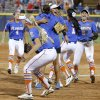The Florida team including Stephanie Tofft, center facing camera, react after beating Nebraska in the fifteenth inning of their the Women\'s College World Series softball game at ASA Hall of Fame Stadium in Oklahoma City, Saturday, June, 1, 2013. Photo by Bryan Terry, The Oklahoman