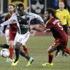 Photo - Portland Timbers' Kalif Alhassan (11)works against Real Salt Lake's Kyle Beckerman (5) during the first half of an MLS Soccer game in Portland, Ore., Saturday, Oct. 19, 2013. (AP Photo/Greg Wahl-Stephens)