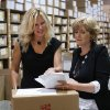 Photo - In this July 31, 2014 photo, Marcia Cubitt, president, Essential Bodywear, left, and CEO Carrie Charlick talk in their warehouse in Commerce Township, Mich. Charlick and Cubitt have $4 million in sales but have been rejected for $500,000 credit lines since 2012. (AP Photo/Paul Sancya)