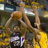 Sacramento Kings\' Isaiah Thomas puts up a shot in the first quarter against Indiana Pacers\' George Hill, Saturday, Nov. 3, 2012, in Indianapolis. (AP Photo/Doug McSchooler)