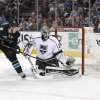 Photo - Los Angeles Kings goalie Jonathan Quick (32) blocks a goal attempt by San Jose Sharks center Logan Couture (39) during the first period in Game 3 of their second-round NHL hockey Stanley Cup playoff series, Saturday, May 18, 2013, in San Jose, Calif. (AP Photo/Tony Avelar)