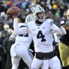 Photo -  Brigham Young quarterback Taysom Hill throws a pass in the first half of a game last November at Notre Dame.  (AP Photo/Joe Raymond)