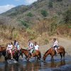 Photo - This February 2014 photo released by Kristina MacKulin shows a group of horseback riders on a tour with outfitters Nosara Paradise Rentals, in Nosara, Costa Rica. Nosara is a scenic coastal region with a variety of outdoor recreation activities for visitors. (AP Photo/Kristina MacKulin)
