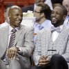 Photo - Miami Heat guards Ray Allen, left, and Dwyane Wade laugh as they sit on the bench during the first half of an NBA basketball game against the Milwaukee Bucks, Wednesday, April 2, 2014, in Miami. (AP Photo/Wilfredo Lee)