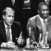 OU: University of Oklahoma college basketball star Wayman Tisdale (left) flanked by Sooner head coach Billy Tubbs, at a news conference Saturday announced he was making himself available for the National Basketball Association (NBA) draft. The three-time All-America had one year of college eligibility remaining. (Original photo dated 05/04/84.)
