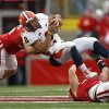 Illinois quarterback Nathan Scheelhaase (2) is tackled by Wisconsin\'s Ethan Armstrong, left, and Konrad Zagzebski during the second half of an NCAA college football game on Saturday, Oct. 6, 2012, in Madison, Wis. (AP Photo/Andy Manis)