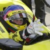Photo - Jacques Villeneuve, of Canada, puts on his gloves as he prepares to drive during practice for the Indianapolis 500 IndyCar auto race at the Indianapolis Motor Speedway in Indianapolis, Tuesday, May 13, 2014. (AP Photo)