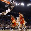 Oklahoma City\'s James Harden dunks the ball over Houston\'s Jordan Hill, left, and Brad Miller during the NBA basketball game between the Oklahoma City Thunder and the Houston Rockets at the Oklahoma City Arena on Wednesday, December 15, 2010. Photo by Bryan Terry, The Oklahoman