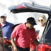Photo - Tiger Woods loads a vehicle as he prepares to leave after withdrawing having played 13 holes in the final round of the Honda Classic golf tournament on Sunday, March 2, 2014, in Palm Beach Gardens, Fla. (AP Photo/Wilfredo Lee)
