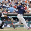 Boston Red Sox\'s Shane Victorino, right, singles to drive in two runs in the fourth inning as Detroit Tigers catcher Brayan Pena, left, works behind the plate during a baseball game on Friday, June 21, 2013, in Detroit. (AP Photo/Duane Burleson)