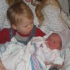Big brother Caleb meets his baby sister Megan for the first time. Community Photo By: Brian Shafer (father) Submitted By: Kimber, Edmond