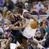 Philadelphia 76ers\' Jrue Holiday, right, tries to keep the ball from Atlanta Hawks\' Jeff Teague during the first half of an NBA basketball game, Friday, Dec. 21, 2012, in Philadelphia. (AP Photo/Matt Slocum)