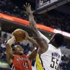 Toronto Raptors\' DeMar DeRozan (10) shoots against Indiana Pacers\' Roy Hibbert (55) during the first half of an NBA basketball game, Tuesday, Nov. 13, 2012, in Indianapolis. (AP Photo/Darron Cummings)