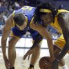 Golden State Warriors center David Lee, left, works against Los Angeles Lakers center Jordan Hill, right for the ball in the first quarter during an NBA basketball preseason game Saturday, Oct. 5, 2013, in Ontario, Calif. (AP Photo/Alex Gallardo)