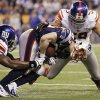 New England Patriots wide receiver Wes Welker (83) is stopped by New York Giants linebackers Jacquian Williams, left, and Michael Boley during the second half of the NFL Super Bowl XLVI football game, Sunday, Feb. 5, 2012, in Indianapolis. (AP Photo/Mark Humphrey) ORG XMIT: SB429