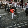 Revelers run in front of Valdefresno ranch fighting bulls during the San Fermin fiestas, Tuesday, July 9, 2013, in Pamplona, Spain. Revelers from around the world come to participate in the street partying festival, which became world famous with the 1926 publication of Ernest Hemingway\'s novel